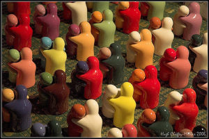 colorful figurines hugging