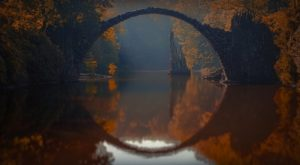 Arch reflected in water
